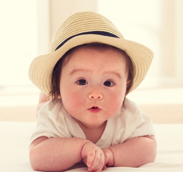 Happy baby boy with straw hat